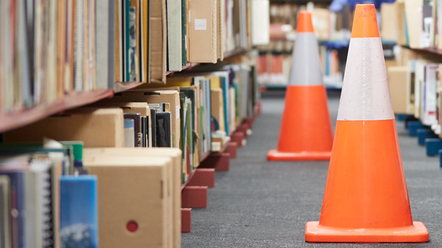 Safety cones by bookshelves
